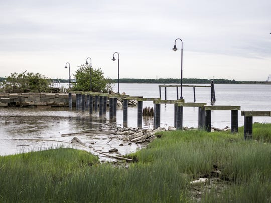 Remnants of the dock in Battery Park in New Castle sit in disrepair earlier this year.