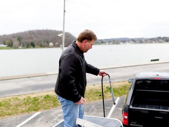 Brian Niekerk  holds one of the underwater spray hoses on his boat in Kingston, Tennessee on Wednesday, March 7, 2018. Brian Niekerk and Mack Schmidt launched their company Lake Weed Controls to combat invasive aquatic plants like hydrilla in residential and commercial waterfront properties.