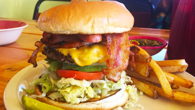 Jacalito's Mexa Burger ($8.29) is topped with ham, bacon, Mexican frank (hot dog), and avocado with the traditional patty and fixings of cheese, lettuce, and tomato, and served with a side of fries.