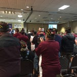 Members of the Veterans of Foreign Wars stand up and clap at Friday's conference, the 52nd annual VFW Mid-Winter Conference.