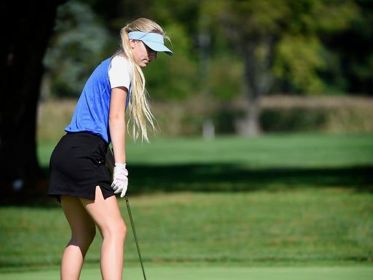 Cedar Crest golfer Skylar Hanford putts during the