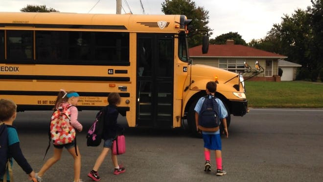 Shields Elementary students board the morning bus on Savannah Road near the Covey Creek development in Lewes.