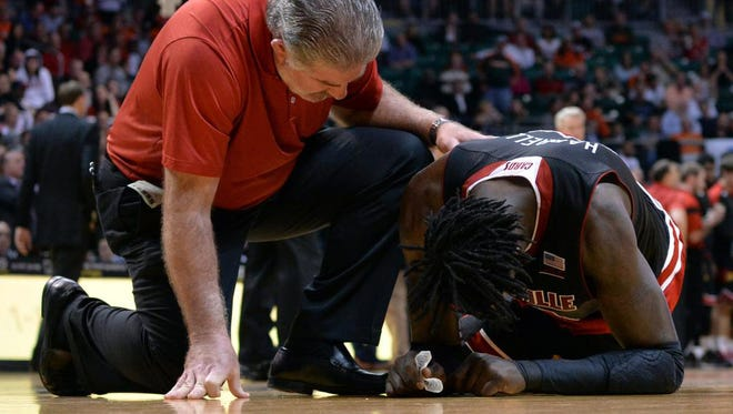 Feb 3, 2015; Coral Gables, FL, USA; Louisville Cardinals forward Montrezl Harrell (24) is injured after colliding with Miami Hurricanes guard Angel Rodriguez (not pictured) during the second half at BankUnited Center. Mandatory Credit: Steve Mitchell-USA TODAY Sports