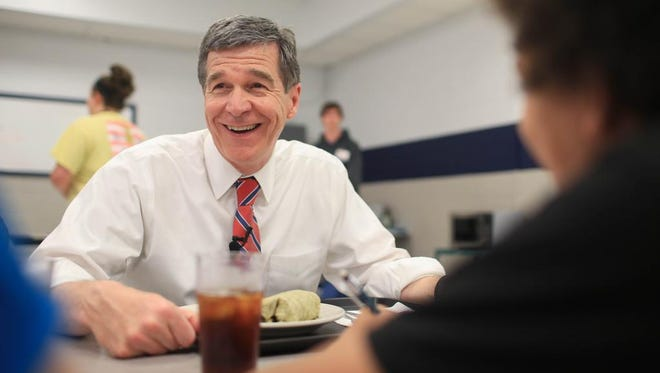 "North Carolina Governor Roy Cooper talks with students during the United Way's ""Homework Diner"" in April at Enka Middle School.  Cooper attended the event as part of National Volunteer Week in North Carolina."