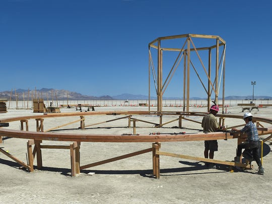 Jelly Bean, left, and Scoot work on a wooden circle that will encircle the man this year, as in Da Vinci's The Vitruvian Man drawing. This year's Burning Man theme is Da Vinci's workshop.