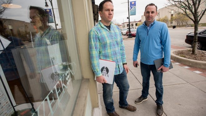 Jason Stoltz, left, and Leo Colantuono talk about their new business they are launching that will allow a new way of delivery for Blue Water area restaurants Monday, April 3, outside their work space at Loft 912 in Port Huron.