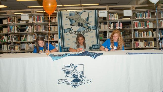 Enka seniors Danielle Harris, Brittany Fletcher and Mariah Foxworth signed to play college softball on Friday.