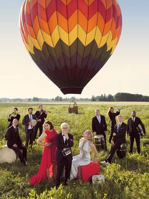 Pink Martini with Storm Large (in white) will perform 7:30 p.m. Friday, May 22, at LaSells Stewart Center Corvallis.