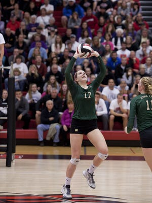 Iowa City West's Maddie Fay sets up a hit for her teammate at the high school girls volleyball 5A Region 7 final at Linn-Mar High School in Marion, Iowa on Tuesday, November 3, 2015.