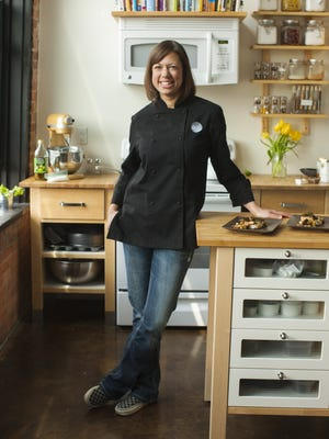 Kristin Klock-Wattie, owner of Root Catering, poses in a 2015 file photo.