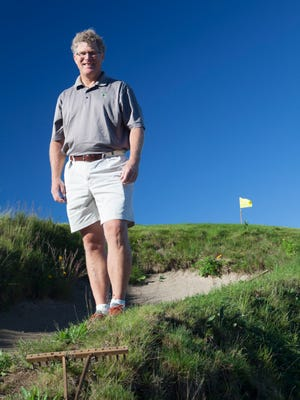 Golf course designer Mike DeVries poses at Kingsley Club.