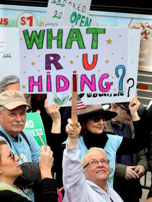 Sue Steele, 69, of Nyack, N.Y. was among thousands who took part in a Tax March in Manhattan April 15, 2017. Protesters, demanding that President Donald Trump release his tax returns, held a rally near Bryant Park and then marched up 6th Ave. and then eventually to Trump Tower.