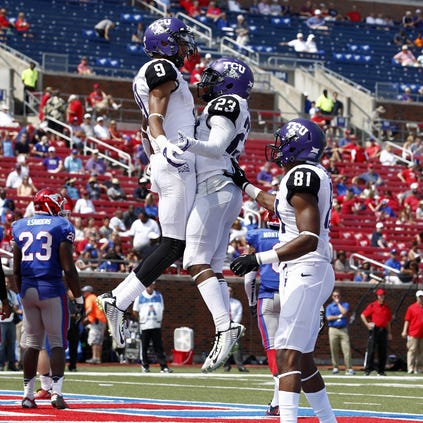 Sep 27, 2014; Dallas, TX, USA; TCU Horned Frogs wide receiver Josh Doctson (9) celebrates scoring a touchdown with running back B.J. Catalon (23) and wide receiver Ja'Juan Story (81) at Gerald J. Ford Stadium. TCU beat Southern Methodist 56-0. Mandatory Credit: Tim Heitman-USA TODAY Sports