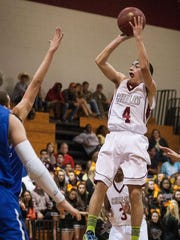 Austin Greene, then a sophomore, nails a 3-pointer during a game between Chiles and Maclay in December 2012.