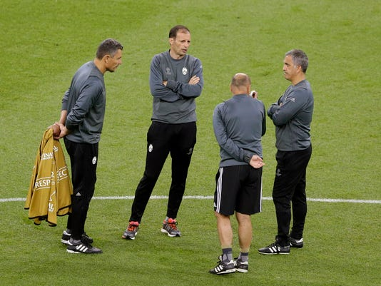 Juventus head coach Massimiliano Allegri, second left, attends a training session at the Millennium Stadium in Cardiff, Wales, Friday June 2, 2017. Real Madrid will play Juventus in the final of the Champions League soccer match in Cardiff on Saturday. (AP Photo/Alastair Grant)