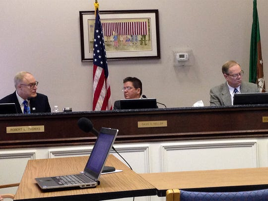 Franklin County commissioners (from left) Robert Thomas, David Keller and Robert Ziobrowski discuss budget options on Tuesday.