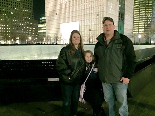 Nate Tracey, his wife Wendy Tracey, and their daughter Brooke, stand at the World Trade Center Memorial in New York City in March. Nate Tracey, who is chief of the Goodwill Fire Company, recalls how in the months following 9/11, residents would stop by fire stations just to say 'Thank you.'