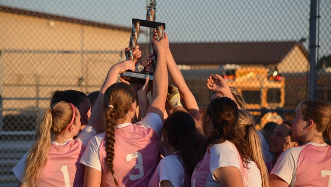 Pennfield raises the All-City championship trophy after beating Lakeview.
