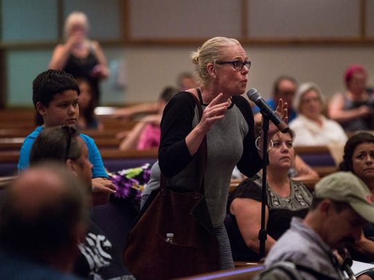 A resident tells her story during the FEMA Town Hall at the First Presbyterian Church in Bonita Springs on Friday, Sept. 22, 2017.
