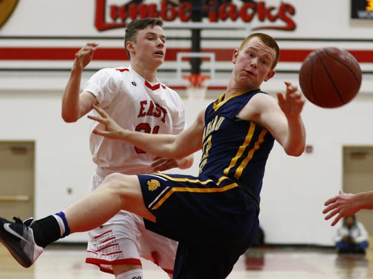 Wausau West's Jakob Tordsen, right,Wausau East's Sawyer Schlindwein battle for a rebound in a game earlier this year. Both players were first team all-Wisconsin Valley Conference selections this  season.