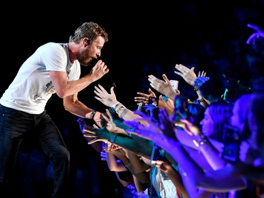 """Dierks Bentley performs at last year's CMA Music Festival. After recently listening to Marie Kondo's book """"The Life-Changing Magic of Tidying Up,"""" Bentley's goal is to pare down to a couple of pairs of jeans and a handful of black T-shirts and white T-shirts."""