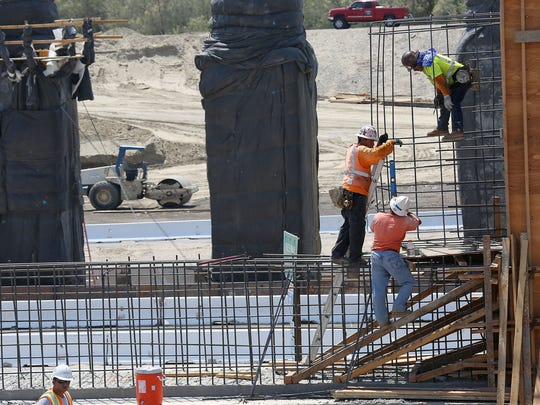 Crews work on construction of the new Jefferson Street Interchange project in Indio.