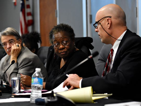 York City School District board members, from left,