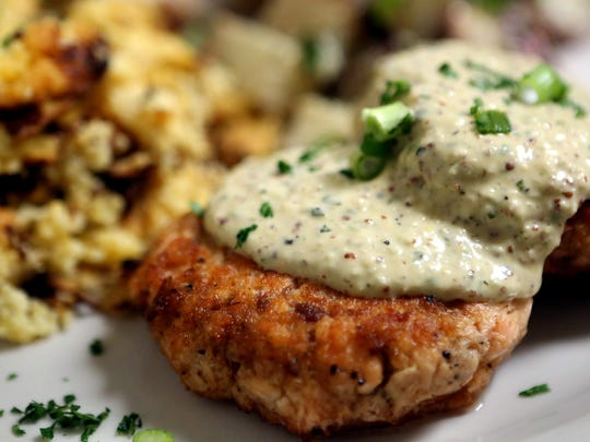 March 16, 2017 - Homemade salmon patties with Cajun remoulade and cornbread pudding at Pharm2Fork, located in Collierville.