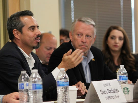 "Rep. Antonio ""Moe"" Maestas, left, co-chair of the legislative"