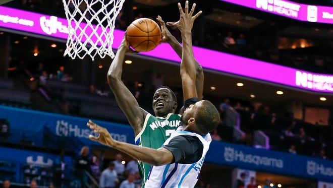 Bucks forward Thon Maker shoots the ball as Charlotte Hornets forward Michael Kidd-Gilchrist defends.