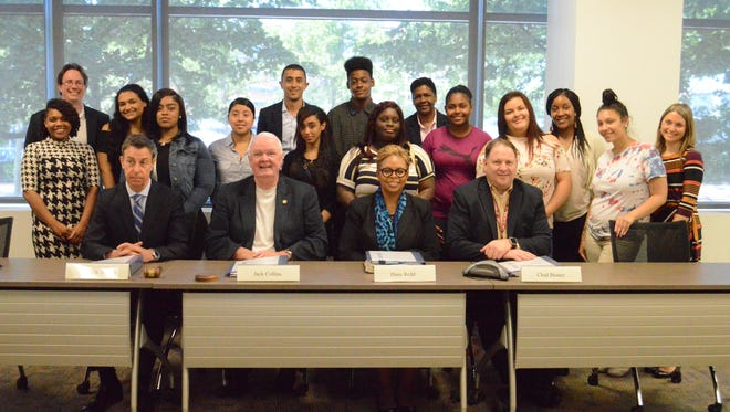 Members of the Rowan University Rutgers Camden Board of Governors are shown with students who are joining the Medical Assistants Training Program.
