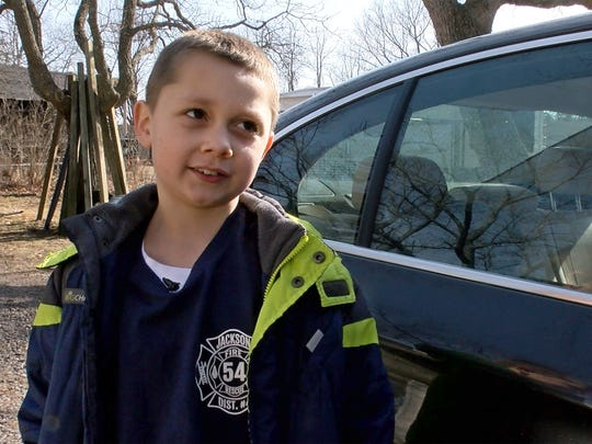 Jace Sorchinski is interviewed outside his Jackson Township home Sunday, January 21, 2018.   His mom Nicole had a seizure driving with him to McDonald's. She pulled over in time, but may have stopped breathing. Jace called 911 and kept talking to her through the seizure, possible saving her life.