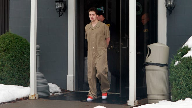 Colby Reed, 23, of Pittsford leaves Pittsford Town Court after pleading not guilty to four charges for allegedly robbing garages and assaulting a deputy Sunday.