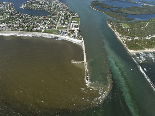 Dirty water filled with sediment and toxins in the Indian River Lagoon spews out from the Fort Pierce Inlet into the Atlantic shoreline as seen on Wednesday, Oct. 11, 2017 in Fort Pierce. Excess water from Lake Okeechobee released through the St. Lucie Locks flowing along the St. Lucie River in Martin County and Taylor Creek in St. Lucie County empties into the Indian River Lagoon, causing toxic conditions and discoloration in the lagoon, which eventually flows through the inlets into the Atlantic Ocean with the changing tides.