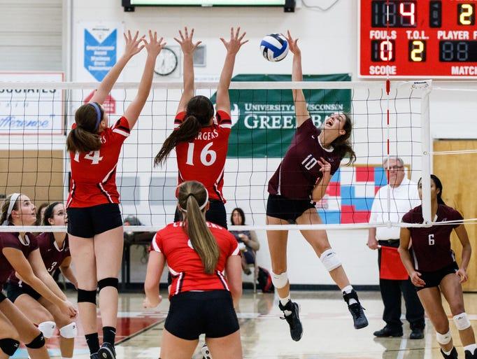 Menomonee Falls sophomore Ashley Guenveur (10) elevates