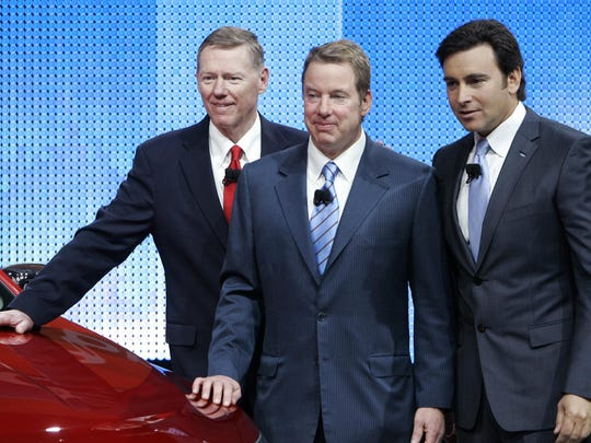 Ford Motor Co. CEO and president Alan Mulally, left, executive chairman Bill Ford and president of the Americas Mark Fields pose together at the North American International Auto Show on Sunday, Jan. 11, 2009 in Detroit.