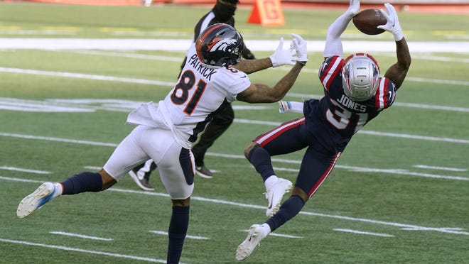 Patriots defender Jonathan Jones intercepted this pass intended for Broncos receiver Tim Patrick in the fourth quarter on Sunday.