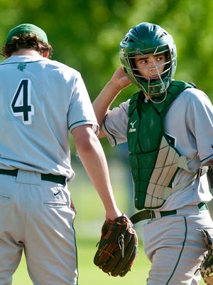 Rice Memorial catcher Sean Remillard, right, confers with pitcher William Hesslink against CVU in Hinesburg on Tuesday.