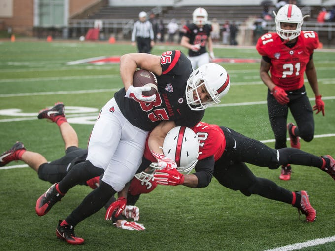 Ball State's Antwan Davis is tackled by Lamar Anderson