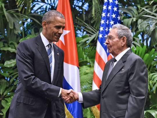 Former-President Barack Obama, left, and Cuban President