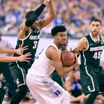 Duke's Justise Winslow calls a timeout as MSU's Alvin Ellis III pressures him near in Indianapolis Friday 4/3/2015.