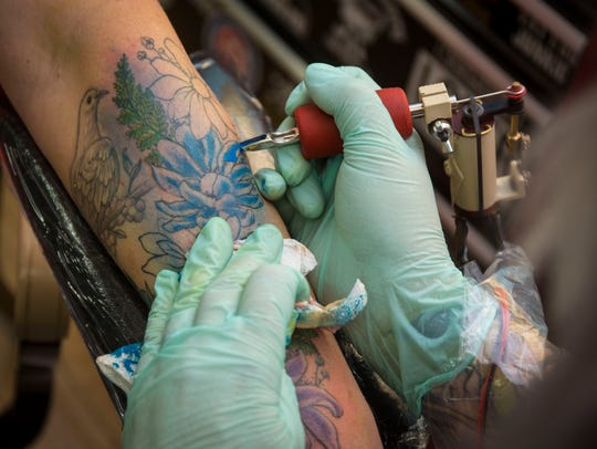 Molly Free, a tattoo artist at Creative Images in