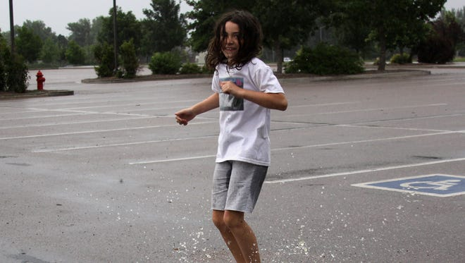 Lindsay Knight couldn't help but jump in the puddles as she left Eastman Park in the rain Tuesday night.