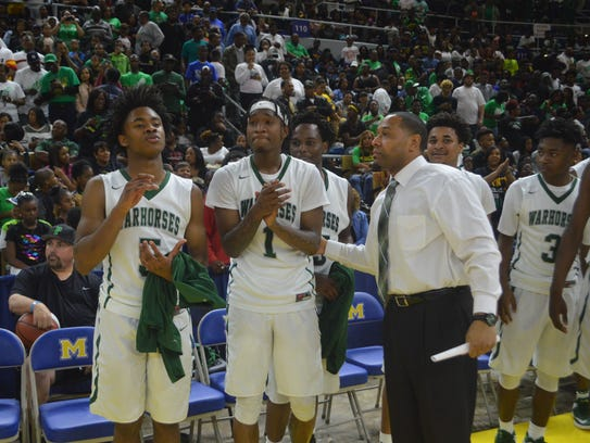 An emotional Cedric Russell (center) is set to pick