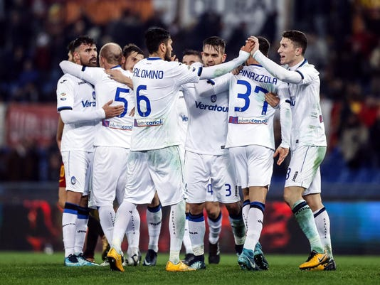 Atalanta players celebrate their 2-1 win over Roma, at the end of a Serie A soccer match at the Olympic stadium in Rome, Saturday, Jan. 6, 2018. (Angelo Carconi/ANSA via AP)