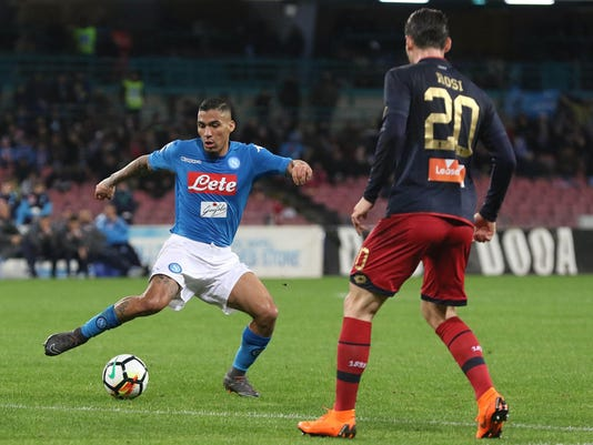 Napoli's Allan, left, and Genoa's Aleandro Rosi challenge for the ball during an Italian Serie A soccer match between Napoli and Genoa, at the San Paolo stadium in Naples, Sunday, March 18, 2018. (Cesare Abbate/ANSA via AP)