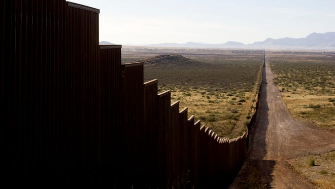 Part of the newer border fence runs east of Naco.