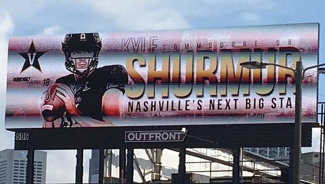 A billboard featuring Vanderbilt quarterback Kyle Shurmur is displayed in Atlanta near the College Football Hall of Fame.