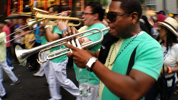 Bands parade through town on their way to a Battle of the Bands during Summer Carnival in Rotterdam.