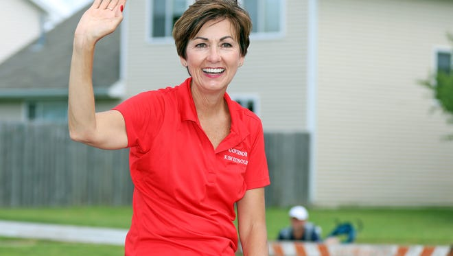 Iowa Governor Kim Reynolds rides along NW 18th St as an estimated 20,000 spectators enjoy the SummerFest Grand Parade on Saturday, July 14, 2018 in Ankeny.